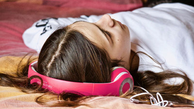 Woman sleeping wearing headphones