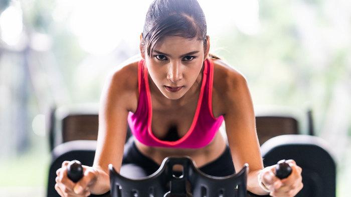 Female athlete on a spin bike